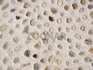 Kieselsteine in Beton als Hintergrund
