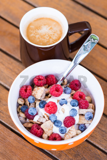 Cornflakes with fresh fruits, yogurt and coffee