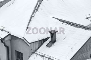 snow on metal tiles roofing in winter