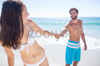 Smiling couple holding hands