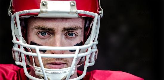 Composite image of portrait of focused american football player wearing his helmet