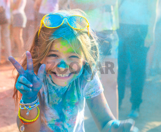 Portrait of happy litttle girl on holi color festival