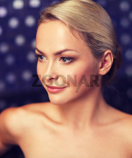 close up of young woman sitting in bath towel