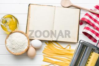 cookbook and pasta ingredients