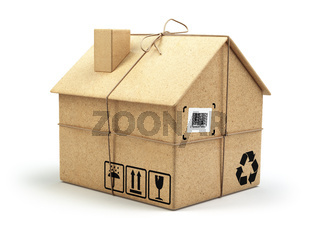 Moving house. Real estate market. Delivery concept. Cardboard box as home isolated on white
