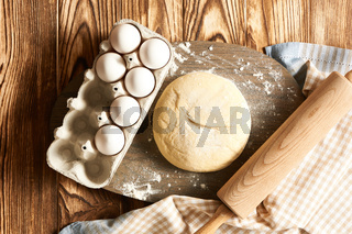 Dough and ingredients on table
