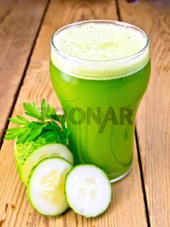 Juice cucumber in tall glassful on board