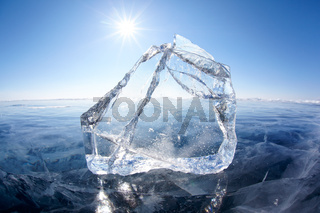 Ice floe and sun on winter Baikal lake