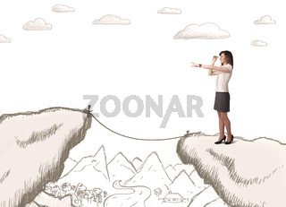 Businesswoman with drawn edge of mountain
