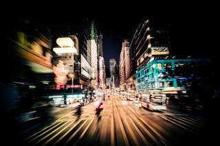 Modern city motion blur. Hong Kong. Abstract cityscape traffic background