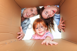 Family in a cardboard box ready for moving house