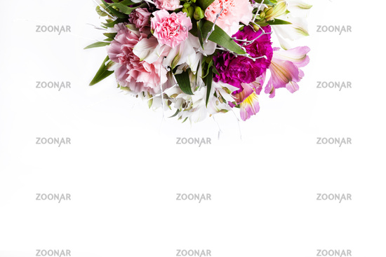Bouquet from pink and purple gillyflowers on white background