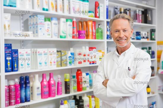 Senior pharmacist smiling at camera