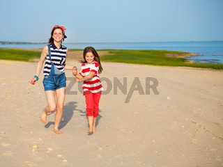 Happy sister playing on beach