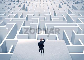 Businessman staring at infinite maze