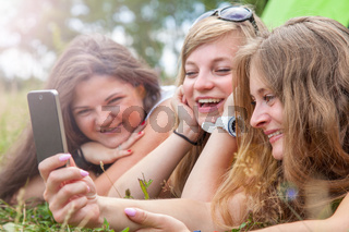 Group of friends having fun outdoors with a smart phone