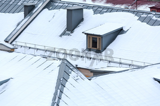 top view on snowy roofs of city houses