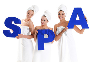 women holding spa letters