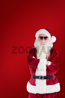 Composite image of santa claus wears black sunglasses