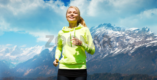 happy sporty woman running or jogging outdoors