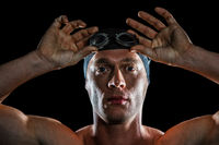 Portrait of swimmer wearing swimming goggles