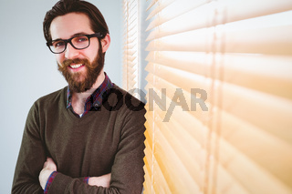 Hipster businessman smiling at camera