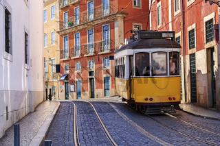 Vintage Lisbon tram on city street