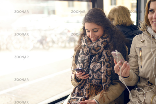 Happy woman reading a message on her mobile phone
