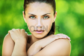 beautiful woman with bare shoulders crossed her arms