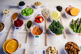 Portion cups and spoons of healthy ingredients