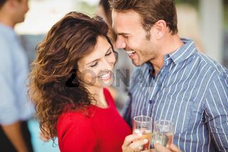 Romantic couple having drinks