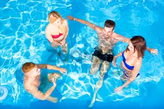 Young people having fun in the pool