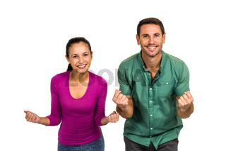 Triumphant couple raising fists