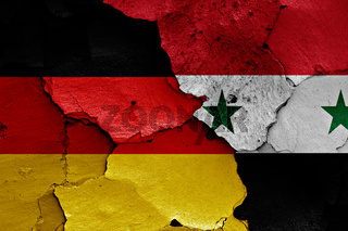flags of Germany and Syria painted on cracked wall