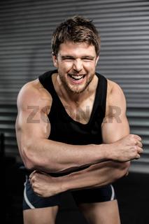 Smiling fit man screaming