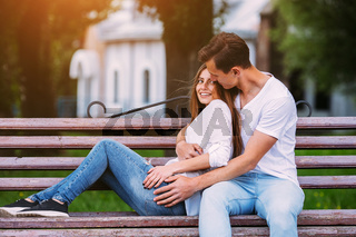 man and woman on a bench in the park