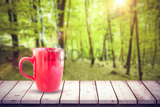 Composite image of red mug on white background
