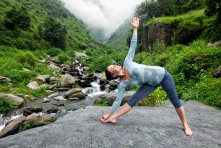 Woman doing Ashtanga Vinyasa yoga asana outdoors