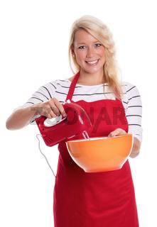 hausfrau in schürze mit schüssel und mixer