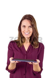 Pretty brunette showing tablet pc