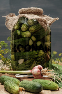 Jar of pickles on wooden table