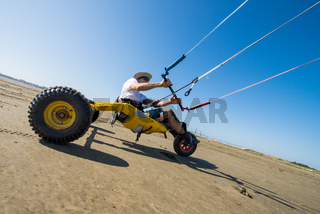 Ralph Hirner riding a kitebuggy