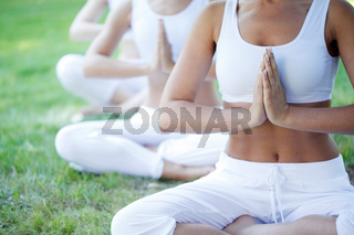 group yoga session at park