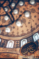 ISTANBUL, TURKEY - MAY 5, 2014: Beautiful decorated interior of the Yeni Cami, meaning New Mosque; originally the Valide Sultan Mosque (Turkish: Valide Sultan Camii)