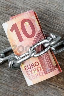 Ten euro bills with chain