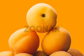 yellow peach slices on plate isolated on yellow
