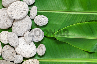 Banana leaves and stones