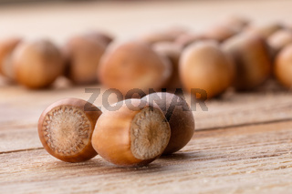 Hazelnuts on brown wooden table