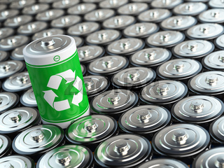 Battery recycling concept. Green energy, Background from battaries and one with green recycling sign.
