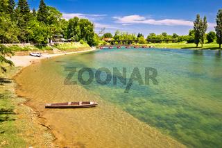 Korana river beach and wooden boat